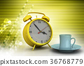 Alarm clock with cup of tea 36768779