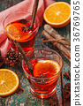 Christmas mulled wine on a rustic wooden table. 36769765
