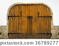 The texture of wooden gates with forged details 36789277