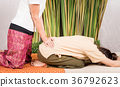 Woman is getting Thai massage treatment on hips 36792623