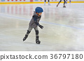 Adorable little boy with protections skating 36797180