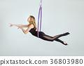 Acrobat hung on hula Hupe. 36803980