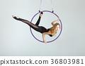 Acrobat on the hula hupe vvurhu does tricks. 36803981