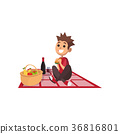 Young happy boy sitting on picnic plaid and eating 36816801
