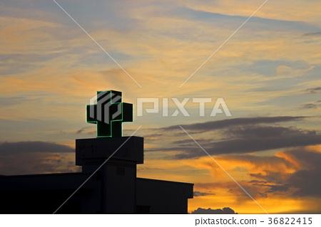 Hospital symbol plus with evening sky look sad 36822415