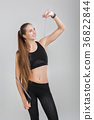 athletic woman holding a rope 36822844