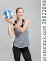 sports woman holding a volleyball 36822848