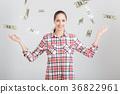 happy woman standing under money rain 36822961