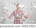 happy woman standing under money rain 36822963