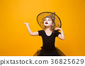 Small girl in Halloween witch costume, orange 36825629