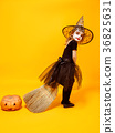 Small girl in Halloween witch costume 36825631