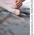 Little girl with pointe shoes 36829520