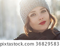 Beautiful young girl in a white winter forest 36829583