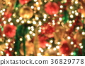 Christmas tree on abstract light golden bokeh 36829778