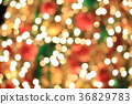 Christmas tree on abstract light golden bokeh 36829783