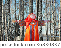 Maslenitsa Scarecrow in winter sunny day 36830837