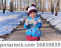 Little girl in winter sunny day 36830839