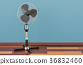 Standing pedestal electric fan in room 36832460