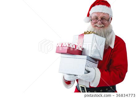 Santa Claus holding gift boxes 36834773