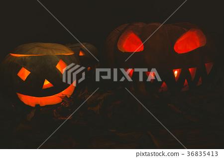 Jack o lantern glowing during Halloween 36835413