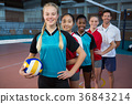 Male coach and volleyball players standing in a row 36843214