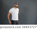Handsome man posing against grey background 36843727