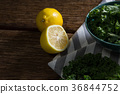 Mustard greens and lemon on wooden table 36844752
