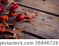 Dry leaves, branches and mistletoe on wooden plank 36846726