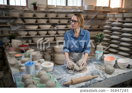 Female potter molding a clay 36847285