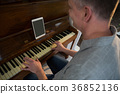 Man playing piano at home 36852136