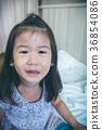Closeup asian child crying with tears sadden. 36854086