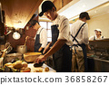 Staff cooking in a cafe kitchen 36858267