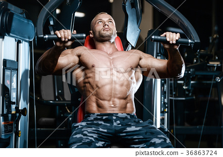 Brutal strong bodybuilder athletic men pumping up muscles with d 36863724