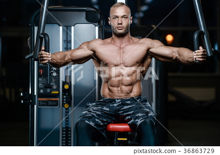 Brutal strong bodybuilder athletic men pumping up muscles with d 36863729