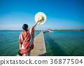 Asian lady walk in wooded bridge to harbor 36877504