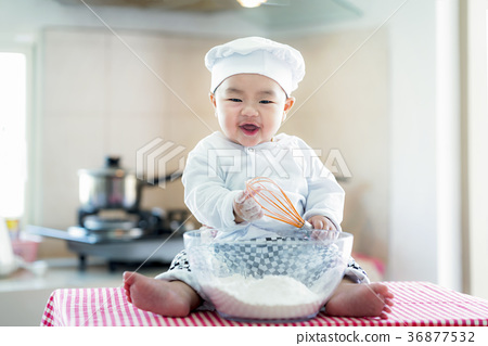 Asian baby in kitchen, newborn baby concept  36877532