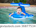 Asian baby play a water and swimming 36877534