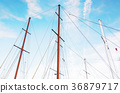 Masts of sailboat and blue sky, beauty filter 36879717