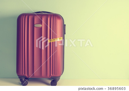 Four wheeled hard shell red suitcase 36895603