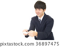 A businessman exchanging business cards 36897475