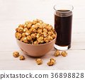 Popcorn in bowl with cola 36898828