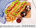 Grilled hot dogs with mustard, ketchup 36898885