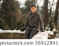 A little boy walks in the park in the winter 36912841