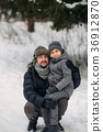 Happy father with his son walks through the park 36912870