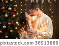 young couple together in christmas decoration 36913889