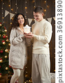 young couple together in christmas decoration 36913890