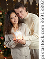 young couple together in christmas decoration 36913892