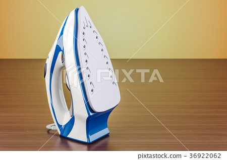Electric steam iron on the wooden table 36922062