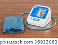 Electronic sphygmomanometer on the wooden table 36922063