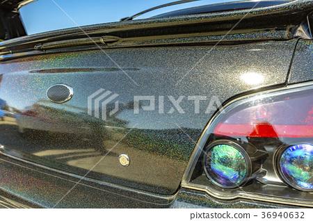 Black sparkled car trunk with emblen taken out 36940632